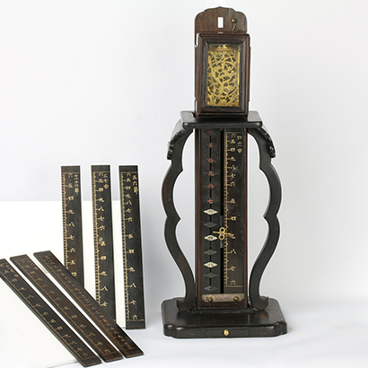 Small Stationary Pillar Clock with Balance Wheel and Replaceable and Segmented Dial Panel