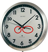 Hand tails on a conventional wall clock design (circled)